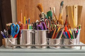 pots of paint brushes and pencils